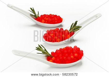 Red Caviar And Rosemary On Porcelain Spoons Uncluttered