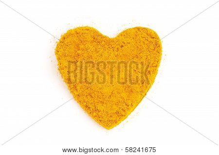 Heap Ground Curry (madras Curry) Isolated In Heart Shape On White Background.