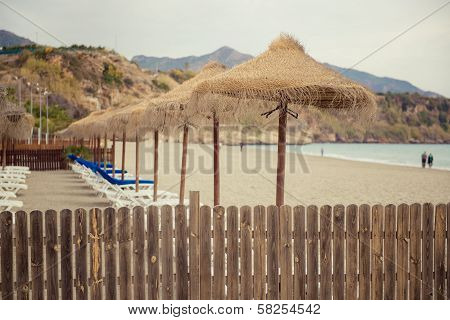 Parasols And Empty Deckchairs On The Nerja Beach.  Spain