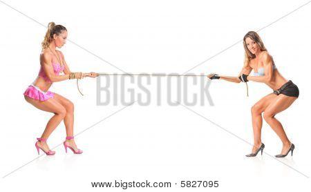 Beautiful girls pulling a rope