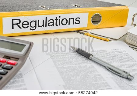 A yellow folder with the label Regulations