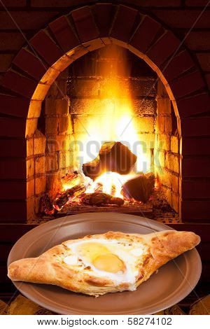 Adzharian Khachapuri With Egg And Fire In Stove