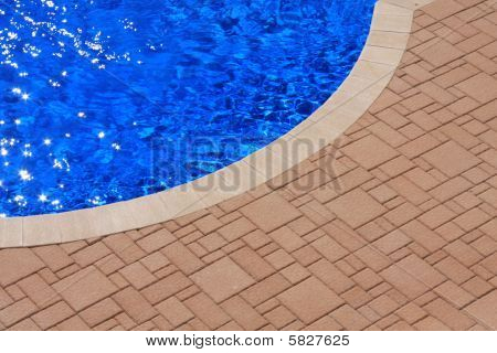 blue pool with patio