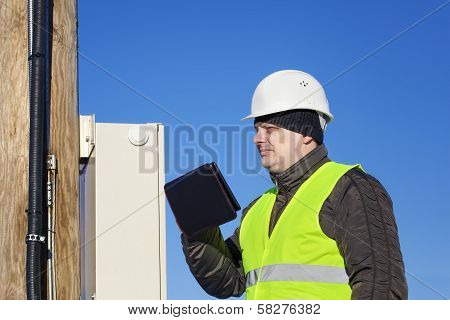Electrician inspect electric lines technical quality