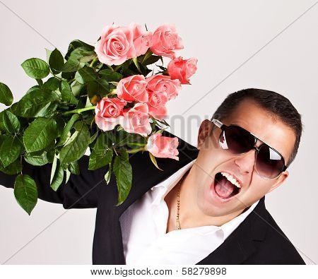 Happy Romantic Husband Holding Rose Flowers.
