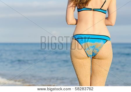 Sandy Woman Buttocks. Place For Your Text.