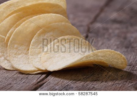 Curved Potato Chips On An Old Table