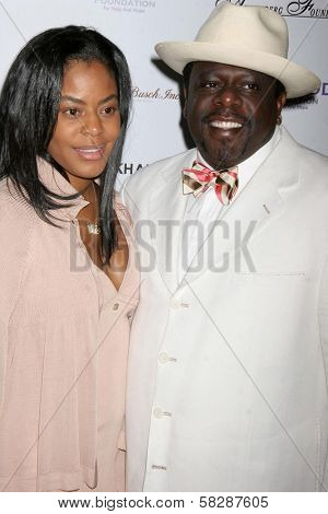 Cedric The Entertainer and wife Lorna at the DESIGNCARE 2007 Fundraiser to benefit those battling debilitating disease and life circumstances. Private Residence, Malibu, CA. 07-21-07