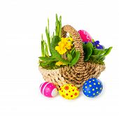 Basket Of Spring Flowers With Easter Eggs