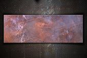 stock photo of ironworker  - Grunge metal plate with screws on metallic grid - JPG