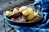 pic of liver fry  - liver with apples on a wood background - JPG