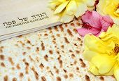 image of seder  - spring holiday of Passover and its attributes, with matzo and Haggadah in Hebrew - Happy Passover