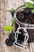 stock photo of blackberries  - Blackberry Jam with fresh fruits isolated on white - JPG