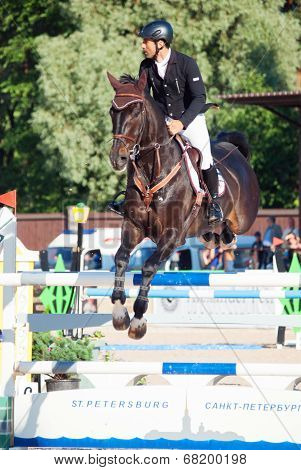 Saint Petersburg-july 05: Rider Mikhail Atoan On Caprille In The Csi3*-w/csiyh1* International Jumpi