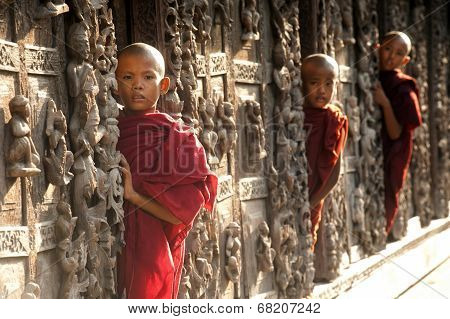 Three Young Monks Standing At Shwenandaw Monastery In Mandalay,Myanmar.