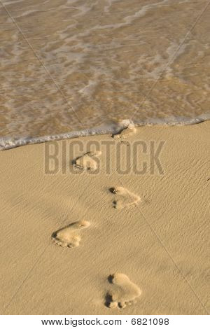Footprints On White Sand Beach