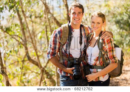 happy young couple hiking in autumn forest