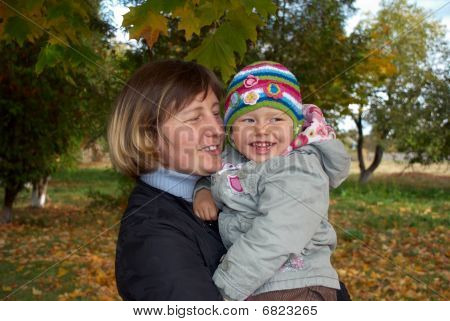Happy Mother And Laughing Daughter