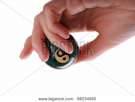 Woman Hand Holding A Ball With Ying And Yang Symbols