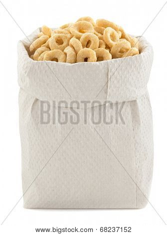 corn flakes rings in paper bag isolated on white background