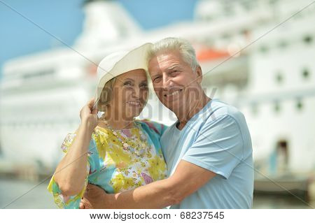 Senior couple standing on pier