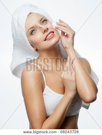 closeup portrait of attractive  caucasian smiling woman blond isolated on white studio shot lips toothy smile face hair head and shoulders blue eyes towel mirrow cleaning cotton disc