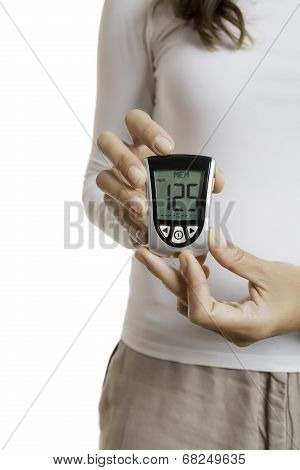 Hands Holding A Glucometer