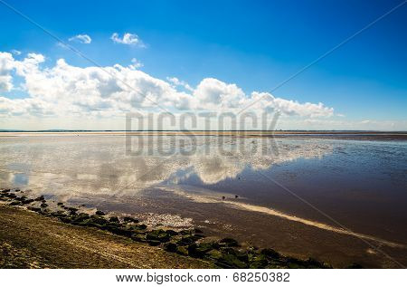 Clouds reflected in coastal water