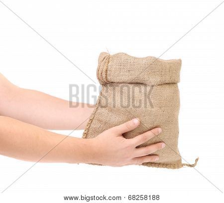 Canvas bag of money in men hand.