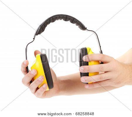 Ear protectors in human hand.