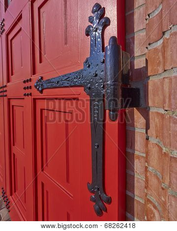 vintage red door and hinge detail