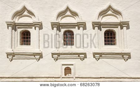 White Brick Wall With Three  Arched Window.