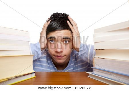 Young Handsome Male Student Sitting Frustrated Between Study Books
