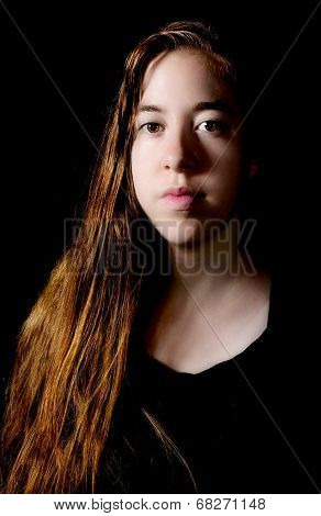 Damatic Low-key Portrait Of A Young Woman
