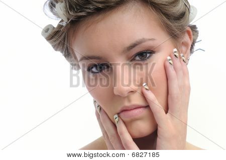 Young Beautiful Woman With Hair Rollers