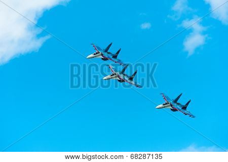 BIG ZAVIDOVO, RUSSIA - JULY 5: Group of russian military jets Su 27 performs at open-air rock festival