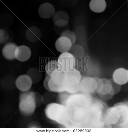 Abstract Black  Light Bokeh Vintage Background With White De Focused Bubbles.