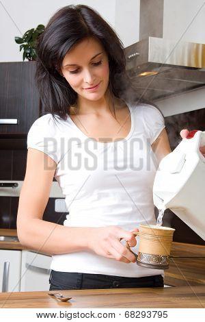 Young Woman Preparing Tea