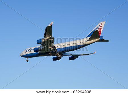 The Boeing-747 plane of Transaero airline decreases before landing at the Sheremetyevo airport
