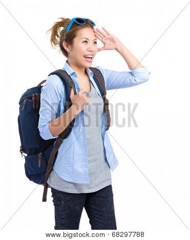 Woman with rucksackand look far away