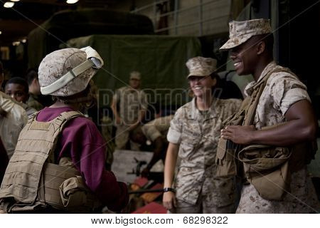 NEW YORK - MAY 22, 2014: Military personnel speaks to visitors during a public tour on the well deck of the amphibious dock landing ship USS Oak Hill (LSD 51) moored at Pier 92 during Fleet Week NY.