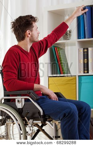 Disabled Man Taking Book