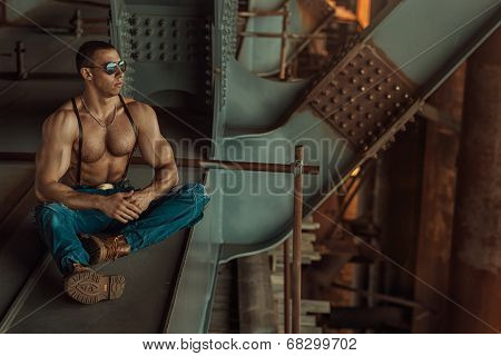 Guy With Glasses Sitting.