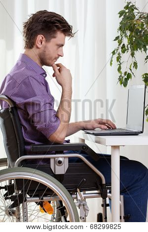 Disabled Man Using A Laptop