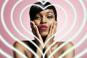 foto of lolita  - portrait of a black woman sending a kiss with neon hearts - JPG
