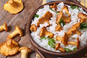 foto of chanterelle mushroom  - Risotto with chanterelle mushrooms in a bowl close - JPG