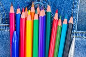 pic of outerwear  - set of multicolored pencils in blue jeans pocket close up - JPG
