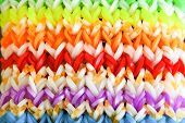 stock photo of loom  - Big colorful rubber rainbow band made on loom - JPG