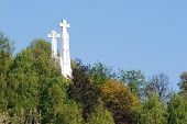stock photo of cross hill  - The Hill of Three Crosses in Vilnius seen from Gediminas hill - JPG