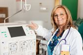 picture of dialysis  - a female doctor showing how to use a dialysis machine - JPG